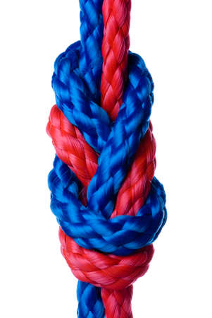 intercommunication: Red and blue synthetic ropes knotted one with onther and isolated on white background