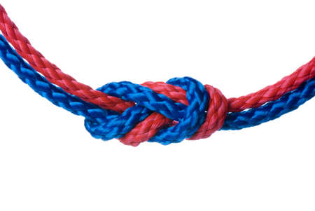 synthetic: Red and blue synthetic ropes knotted one with onther and isolated on white background
