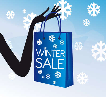 fancy bag: blue and white winter shopping sale with hand over snow landscape background.