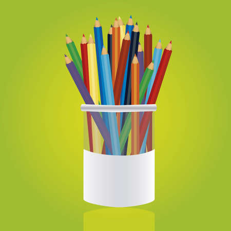 useful: Colores pencils in pencil holders on green background