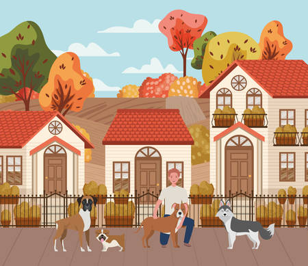 young man with cute dogs mascots in the autumn city scene vector illustration design