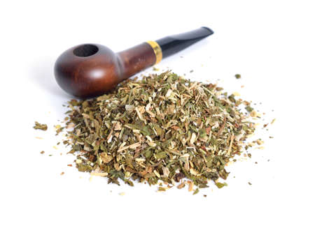 Tobacco pipe with ready-rubbed pipe tobacco. Isolated on white background.
