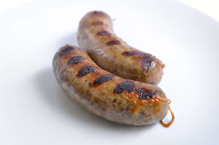 Grilled homemade liver sausages on white plate. Stock Photo