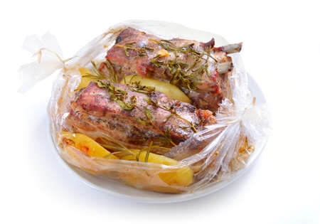meatloaf: Baked meat packaged in a sleeve for baking. Pork belly with greens. Isolated on white background.