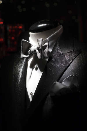 tux: Tuxedo with white shirt and bow-tie