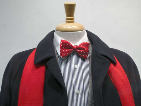 Dark cashmere coat with red scarf, striped shirt with white collar and red bowtie photo