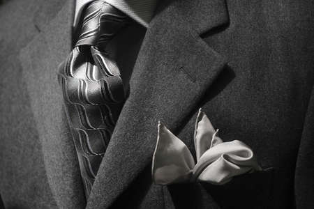 Close up of a grey jacket with grey tie & handkerchief Foto de archivo