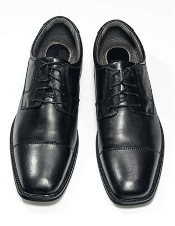 A pair of black men s shoes Isolated on white  Clipping path included  Stock Photo