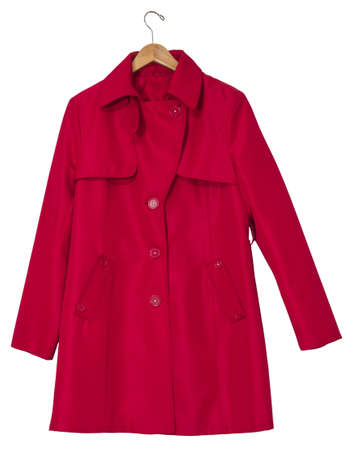 Red women s raincoat on a hanger, isolated on white  Clipping path included  photo