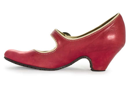 Close-up of a red woman s shoe isolated on white  Clipping path included  photo