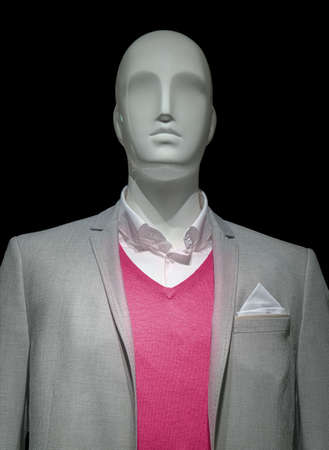 male mannequin: Mannequin in a light gray jacket, red sweater and white shirt on black background  Clipping path included