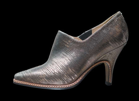shiny background: Shiny silvery womens shoe on black background.  Stock Photo