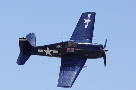 air show: WWII F6F Hellcat Airplane performs at 2014 Chino Air Show