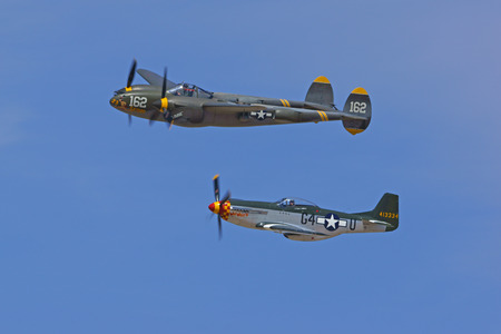 wwii: P-38 Lightning and P-51 Mustang WWII Airplanes flying at 2015 Los Angeles Air Show Editorial