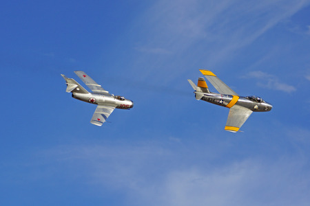 mig: F-86 and Russian MIG jet fighters flying at 2015 Chino Air Show