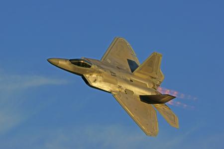 raptor: F-22 Raptor jet fighter flying at twilight Editorial