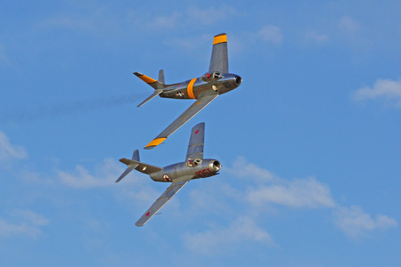 mig: F-86 and MIG fighter flying at 2015 Chino Air Show Editorial