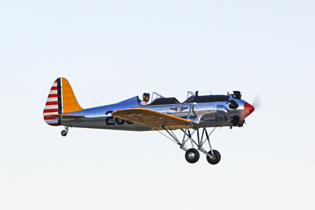 air show: Airplane flying at 2015 Planes of Fame Air Show Editorial