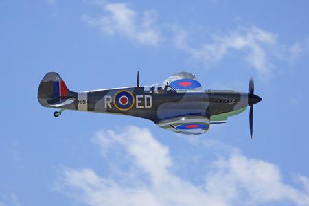 wwii: Spitfire vintage WWII British airplane flying