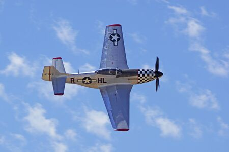 wwii: AirplaneVintage P51 Mustang WWII aircraft flying at Air Show