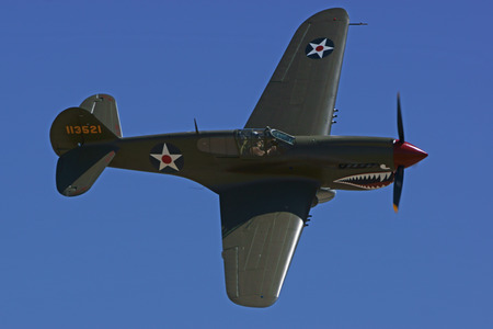 wwii: P40 Warhawk Vintage WWII Airplane flying at Air Show