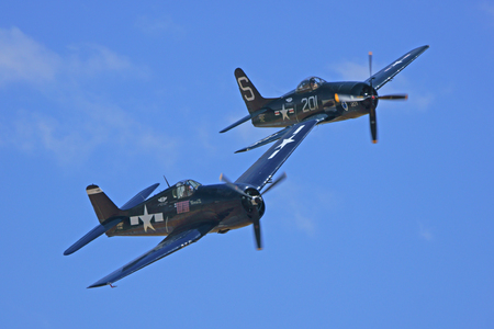 wwii: Navy WWII Airplanes flying in Formation at Air Show Editorial