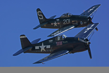 speed gun: Navy WWII Airplanes flying in Formation at Air Show Editorial