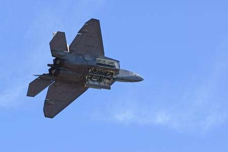 motor launch: F-22 Raptor flying at twilight