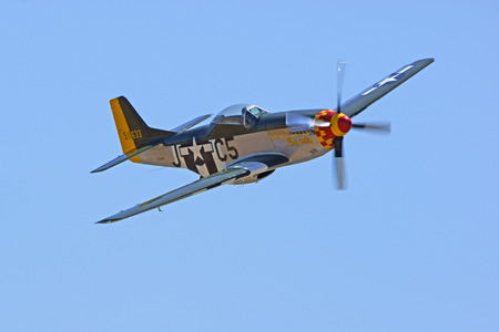 air show: Airplane P-51 Mustang WWII fighter flying at 2015 Air Show