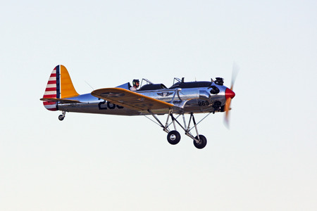 recruit: PT-22 Recruit Trainer airplane flying at Air Show Editorial