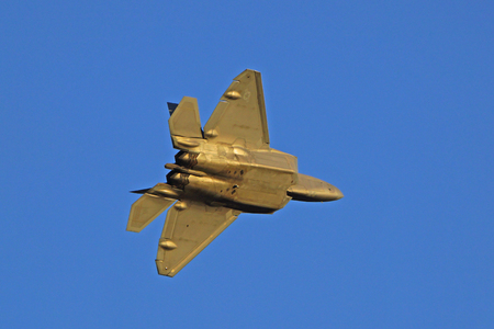stealth: F-22 Raptor modern stealth fighter flying at Air Show