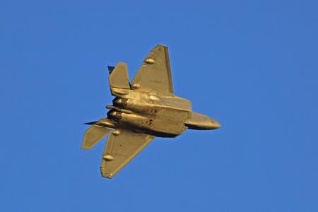 raptor: F-22 Raptor modern stealth fighter flying at Air Show