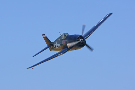 motor launch: Airplane WWII F4 Wildcat airplane flying at Air Show Editorial