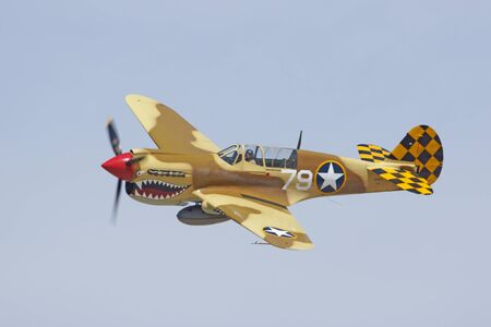 air show: P-40 Airplane flying at 2105 Air Show in California Editorial