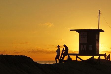 life guard: Beach life guard silhouette sunset