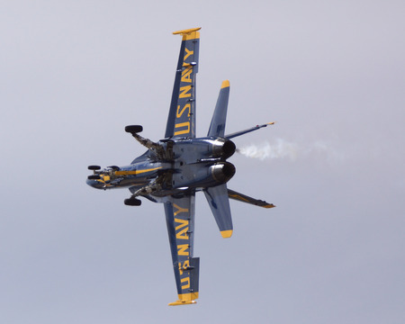 f18: Blue Angels F-18 fighter jet flying at 2014 Air Show Editorial