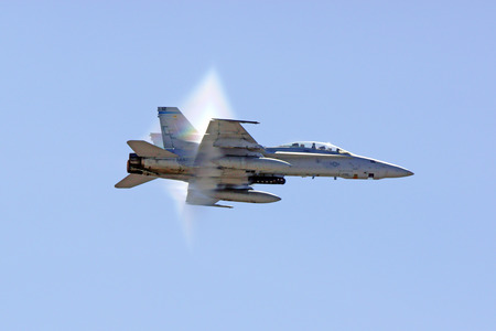 f18: Jet F-18 Hornet airplane breaking the speed of sound Editorial