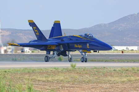 f18: Jet airplane Blue Angels F-18 Hornet on the runway