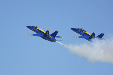 motor launch: Airplanes Blue Angels F-18 Hornet jets flying in formation at 2015 Miramar Air Show Editorial