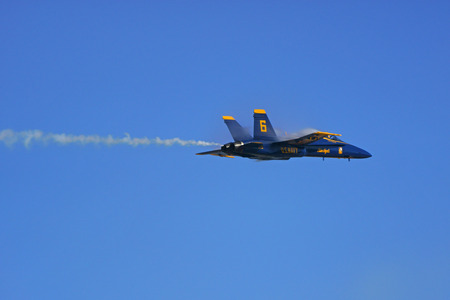 f18: Jet Blue Angels F-18 Hornet fighter flying past air show crowd Editorial