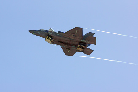 air show: Jet F-35 Lightning stealth aircraft flying over air show crowd Editorial