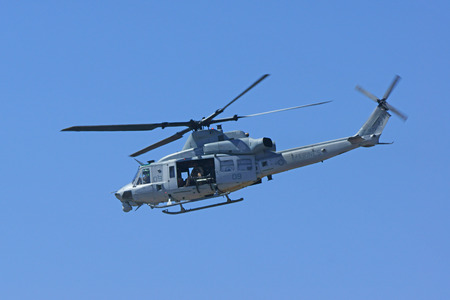 Helicopter Huey aircraft flying at air show