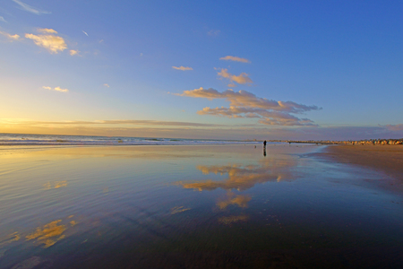 wide  wet: Beach sunset reflection on the wet sand Stock Photo