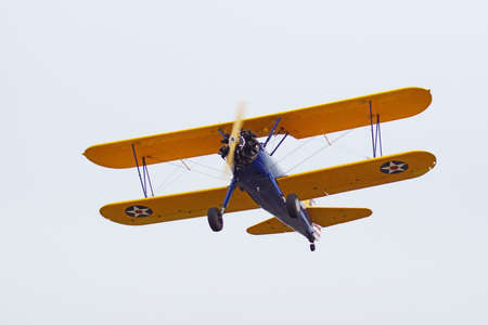 motor launch: Airplane vintage bi-plane flying over air show