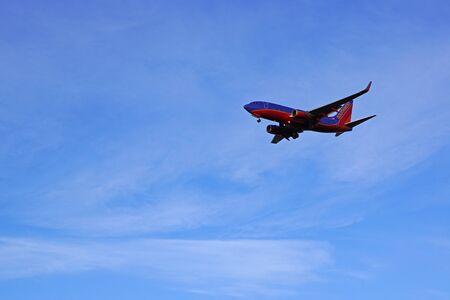 Jet passenger airplane landing at Ontario, California airport Editorial