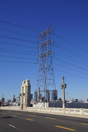 Electrical power tower with Los Angeles city skyline