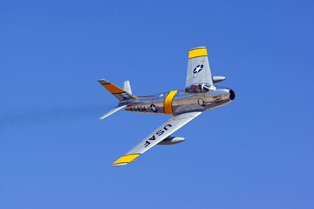 Airplane F-86 Sabre jet fighter flying at air show