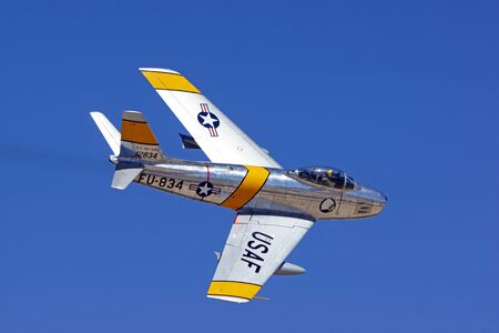 speed gun: Airplane F-86 Sabre flying at air show Editorial