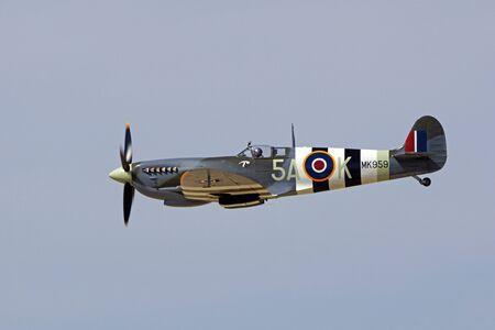 speed gun: Airplane WWII vintage Great Britain Spitfire fighter Editorial
