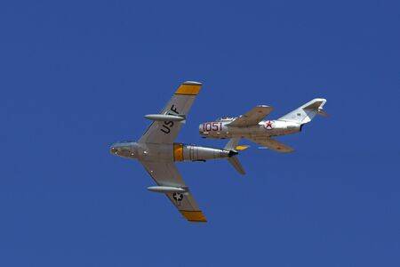 mig: Airplane MIG and F-86 Sabre jets performing at  Air Show